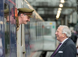100 years to the day from when the celebrated Great War poet Wilfred Owen arrived for treatment in Edinburgh the ocassion was marked with a re-enactment of that arrival and the historic walk he made along Princes Street. Wilfred Owen, portrayed by David Clarke of the Scots in the Great War Historical Society chats with the real Wilfred Owen's nephew Peter Owen upon his arrival at Edinburgh Waverley station.<br /> <br /> © Dave Johnston/ EEm