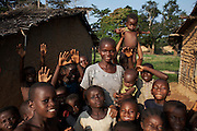Local people in pose for the camera in the village of Lokombe Lokombe by the banks of the Congo river, DR Congo, on Friday, Dec. 5, 2008. The communities here live much as they have done for centuries, with no electricity and little access to the outside world.
