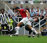 Fotball<br /> England 2005/2006<br /> Foto: SBI/Digitalsport<br /> NORWAY ONLY<br /> <br /> FA Barclays Premiership<br /> Newcastle United v Manchester United<br /> 28th August, 2005<br /> <br /> Newcastle's Emre (R), who was later substituted with a suspected injury, looks to tackle Manchester United's Roy Keane (C).