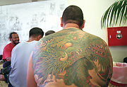 Dragon tattoo on back of large man, Tattoo Convention, New Zealand, 2001,