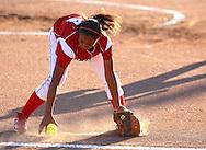 Washington third baseman Bria Lenten, 8th grade, grabs a ground ball at the 4A Regional softball game between Cedar Rapids Washington and Linn-Mar at Jefferson High School at 1243 20th Street SW in Cedar Rapids on Saturday, July 10, 2010. Linn-Mar won 9-1. (Stephen Mally/Freelance)