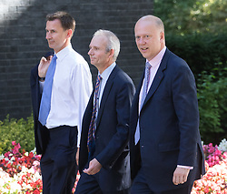 Downing Street, London, July 19th 2016. Health Secretary Jeremy Hunt and Leader of the House of Commons David Lidington, right, arrive at the first full cabinet meeting since Prime Minister Theresa May took office.