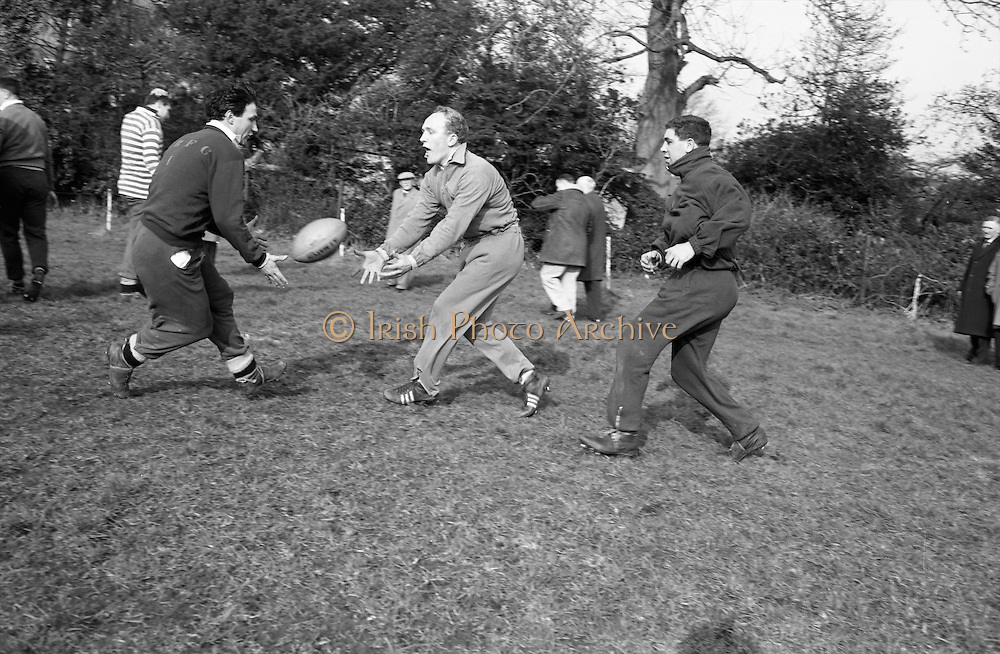 Some short passing between Prothero and Hayward,..Irish Rugby Football Union, Ireland v Wales, Five Nations, Welsh Rugby team pracrice at Palmerstown, Dublin, Ireland, Friday 6th March, 1964,.6.3.1964, 3.6.1964,..Referee- A C Luff, Rugby Football Union, ..Score- Ireland 6 - 15 Wales, ..Welsh Team, ..G T R Hodgson, Wearing number 15 Welsh jersey, Full Back, Neath Rugby Football Club, Neath, Wales,..P Rees, Wearing number 11 Welsh jersey, Left Wing, Newport Rugby Football Club, Newport, Wales, ..K Bradshaw, Wearing number 12 Welsh jersey, Left Centre, Bridgend Rugby Football Club, Bridgend, South Wales,..J Dawes, Wearing number 13 Welsh jersey, Right Centre, London Welsh Rugby Football Club, Surrey, England, ..S J Watkins, Wearing number 14 Welsh jersey, Right Wing, Newport Rugby Football Club, Newport, Wales, ..D Watkins, Wearing number 10 Welsh jersey, Stand Off, Newport Rugby Football Club, Newport, Wales, ..D C T Rowlands, Wearing number 9 Welsh jersey, Captain of the Welsh team, Scrum Half, Pontypool Rugby Football Club, Pontypool, Wales,..D Williams, Wearing number 1 Welsh jersey, Forward, Ebbw Vale Rugby Football Club, Gwent, South Wales,..N R Gale, Wearing number 2 Welsh jersey, Forward, Llanelly Rugby Football Club, Llanelly, Wales,..L J Cunningham, Wearing number 3 Welsh jersey, Forward, Aberavon Rugby Football Club, Port Talbot, Wales, ..B E V Price, Wearing number 4 Welsh jersey, Forward, Newport Rugby Football Club, Newport, Wales, ..B E Thomas, Wearing number 5 Welsh jersey, Forward, Neath Rugby Football Club, Neath, Wales,..G J Prothero, Wearing number 6 Welsh jersey, Forward, Bridgend Rugby Football Club, Bridgend, South Wales,..A Pask, Wearing number 8 Welsh jersey, Forward, Abertillery Rugby Football Club, Gwent, South Wales, ..D J Hayward, Wearing number 7 Welsh jersey, Forward, Cardiff Rugby Football Club, Cardiff, Wales,.