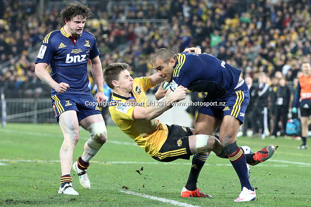 Highlanders' Patrick Osborne is tackled by Hurricanes' Beauden Barrett during the Super Rugby Final, Hurricanes v Highlanders. Westpac Stadium, Wellington, New Zealand. 4 July 2015. Copyright Photo.: Grant Down / www.photosport.nz