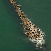 Aerial images of Boats cruising around the Masonboro Jetty, the inlet of which provides passage into the Intracoastal Waterway.