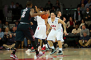 DALLAS, TX - FEBRUARY 6: Nic Moore #11 of the SMU Mustangs defends against Will Cummings #2 of the Temple Owls on February 6, 2014 at Moody Coliseum in Dallas, Texas.  (Photo by Cooper Neill) *** Local Caption *** Nic Moore