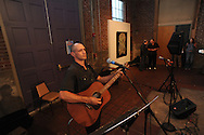 """Matthew Smith plays guitar during the Yoknapatawpha Arts Council's """"Art For Everyone"""" fundraiser in Oxford, Miss. on Tuesday, October 18, 2011."""