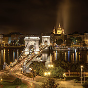 Budapest, Hungary's capital, is bisected by the River Danube, and the 19th-century Chain Bridge connects its hilly Buda district with flat Pest.