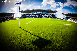The flag at the half-way line casts a shadow on the new plastic pitch, laid at The Falkirk Stadium, for the Scottish Championship game v Hamilton. The woven GreenFields MX synthetic turf and the surface has been specifically designed for football with 50mm tufts compared with the longer 65mm which has been used for mixed football and rugby uses.  It is fully FFA two star compliant and conforms to rules laid out by the SPL and SFL.<br />