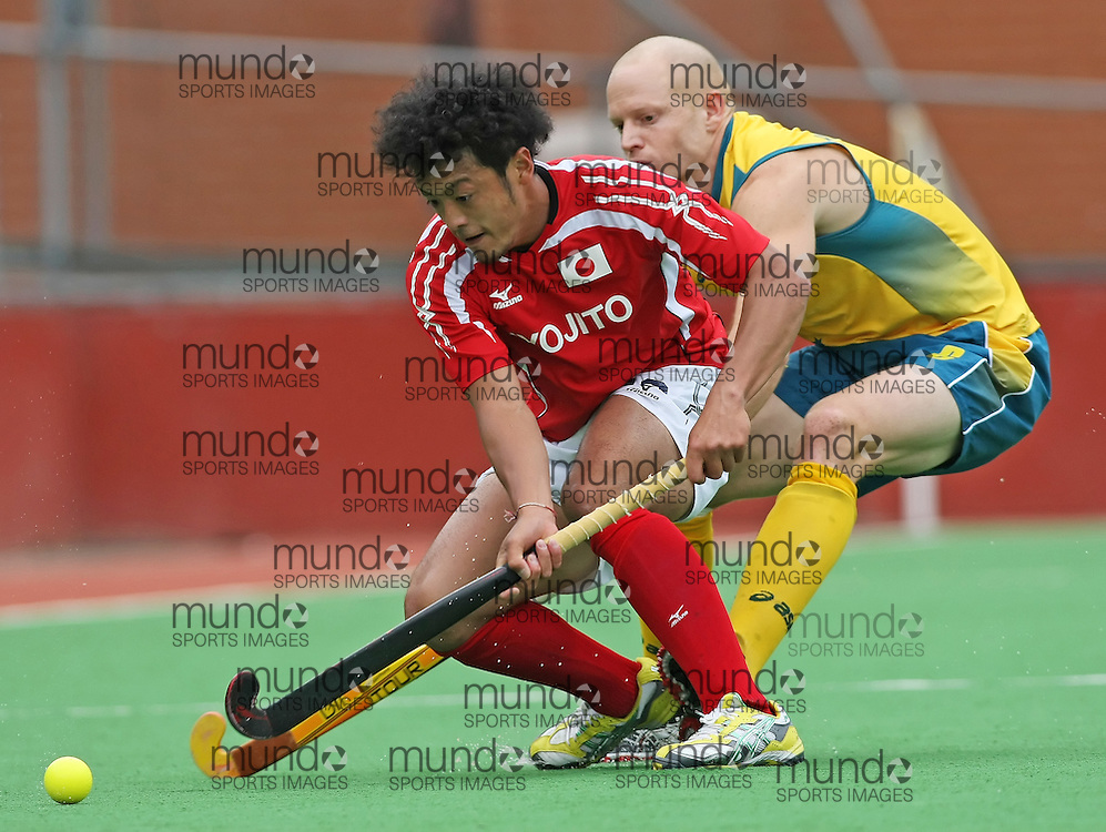 (Canberra, Australia---01 April 2012) Rob Hammond of the Australia Kookaburra national field hockey team and Yoshihiro Anai of Japan during play against Japan in the third of a three game field hockey test series. Australia won the game 7-1 and the series 3-0. Copyright Photograph Sean Burges / Mundo Sport Images, 2012.