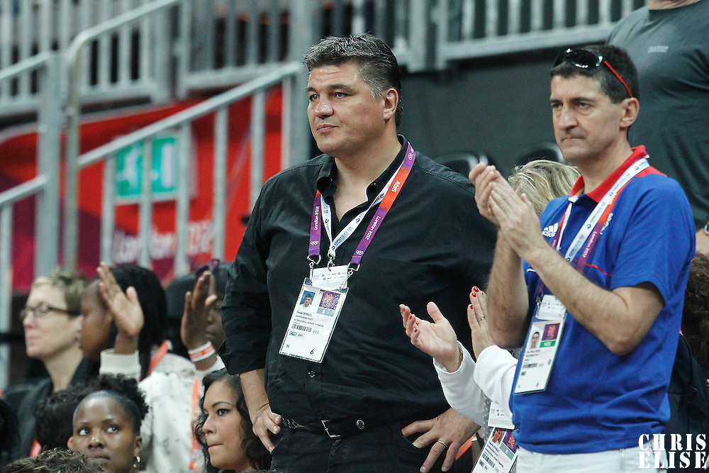 04 August 2012: Former french Judo champion David Douillet is seen next to French Federation President Jean-Pierre Siutat during 73-69 Team France victory over Team Tunisia, during the men's basketball preliminary, at the Basketball Arena, in London, Great Britain.