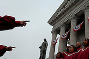 A gospel choir sings on the capitol steps before the arrival of Missouri's new Governor Jay Nixon.