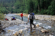 Crossing a creek in the Alaska bush country. North of Bettles, Alaska