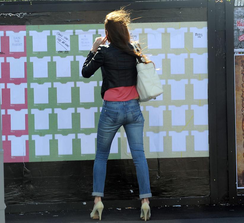 Tight jeans, pedestrian, billboard, Auckland, New Zealand, Thursday, October 20, 2011. Credit:SNPA / Ross Setford