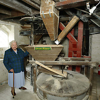 Money Mail Feature.... Aberfeldy Water Mill...14.5.2003.<br />Kathleen Rodger with the mill stones in the Aberfeldy Water Mill<br /><br />Picture by John Lindsay .<br />COPYRIGHT: Perthshire Picture Agency.<br />Tel. 01738 623350 / 07775 852112.