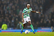 Dedryck Boyata (#20) of Celtic on the ball sporting a bandage on his head following a collision with Gary Mackay-Steven (#11) of Aberdeen during the Betfred Cup Final between Celtic and Aberdeen at Celtic Park, Glasgow, Scotland on 2 December 2018.
