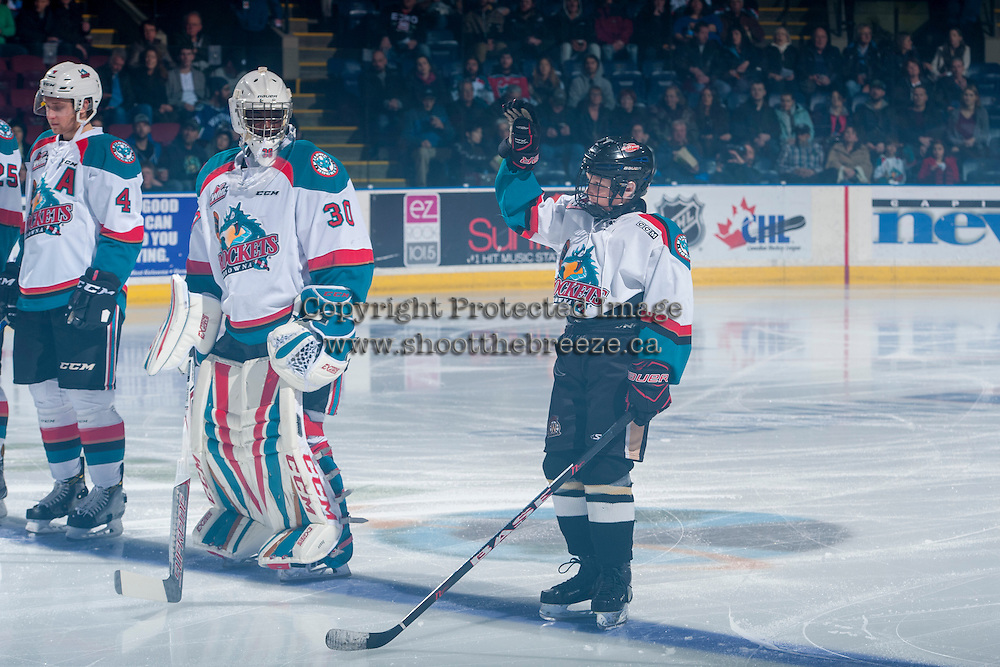 KELOWNA, CANADA - FEBRUARY 18: The Pepsi Save on Foods player lines up beside Michael Herringer #30 of the Kelowna Rockets on the blue line against the Prince George Cougars on February 18, 2017 at Prospera Place in Kelowna, British Columbia, Canada.  (Photo by Marissa Baecker/Shoot the Breeze)  *** Local Caption ***