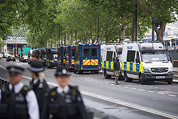 © Licensed to London News Pictures. 06/06/2020. London, UK. A large police presence as Protesters gather in Westminster, central London to take part in a Black Lives Matter demonstration over the killing of African American George Floyd. The death of George Floyd, who died after being restrained by a police officer In Minneapolis, Minnesota, caused widespread rioting and looting across the USA. Photo credit: Ben Cawthra/LNP