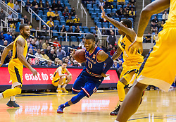 Jan 12, 2016; Morgantown, WV, USA; Kansas Jayhawks guard Frank Mason III (0) drives to the basket during the first half against the West Virginia Mountaineers at the WVU Coliseum. Mandatory Credit: Ben Queen-USA TODAY Sports