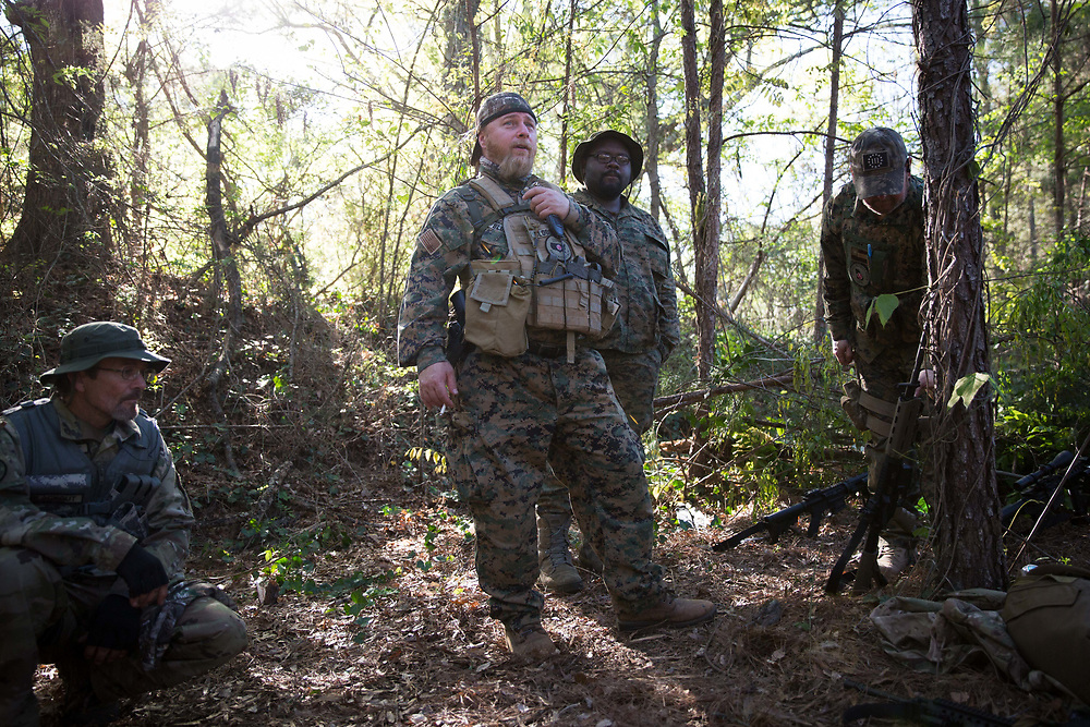 Chris Hill, whose call sign is Blood Agent and is the commanding officer of Georgia Security Force III% militia, prepares to go through a training course built for the group on private property near Jackson, Ga. This photograph was taken on Saturday, April 1, 2017. Photo by Kevin D. Liles for BuzzFeed<br /> <br /> <br /> Shot during a FTX (field training exercises) weekend for Georgia Security Force III% militia, as well as some members for the South Carolina Security Force III%. GSF III% is part of the umbrella group, III% Security Force, which includes groups from several states. Chris Hill (Blood Agent), commanding officer of GSF III%, is the founder of the Security Force movement. According to him, GSF III% membership fluctuates between 30-50 members and growing by about one member per day.  GSF III%, as do the other groups, train one weekend per month.