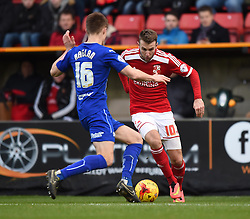 Swindon Town's Andy Williams faces Chesterfield's Charlie Raglan in the Sky Bet League One match between Swindon Town and Chesterfield at The County Ground on January 17, 2015 in Swindon, England. - Photo mandatory by-line: Paul Knight/JMP - Mobile: 07966 386802 - 17/01/2015 - SPORT - Football - Swindon - The County Ground - Swindon Town v Chesterfield - Sky Bet League One