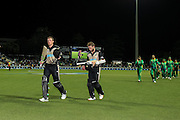 Black Cap's Martin Guptill (L) and Black Cap's Kane Williamson leave the ground after their record unbeaten opening partnership in the second T20 match of the ANZ International T20 series - New Zealand Black Caps v Pakistan played at Seddon Park, Hamilton, New Zealand on Sunday 17 January 2016. Copyright Photo:  Bruce Lim / www.photosport.nz