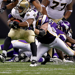 September 9, 2010; New Orleans, LA, USA;  New Orleans Saints running back Pierre Thomas (23) is tackled by Minnesota Vikings defensive end Jared Allen (69) during the NFL Kickoff season opener at the Louisiana Superdome. The New Orleans Saints defeated the Minnesota Vikings 14-9.  Mandatory Credit: Derick E. Hingle