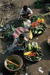 BANGLADESH DHAKA KAWRAN BAZAAR 2MARB05 -  Traders attend to their baskes with fruits and vegetables at Kawran Bazaar vegetable market. The Bazaar has been in the Tejgaon area for at least 30 years and is one of the largest markets in Dhaka city...jre/Photo by Jiri Rezac..© Jiri Rezac 2005..Contact: +44 (0) 7050 110 417.Mobile:  +44 (0) 7801 337 683.Office:  +44 (0) 20 8968 9635..Email:   jiri@jirirezac.com.Web:    www.jirirezac.com..© All images Jiri Rezac 2005- All rights reserved.