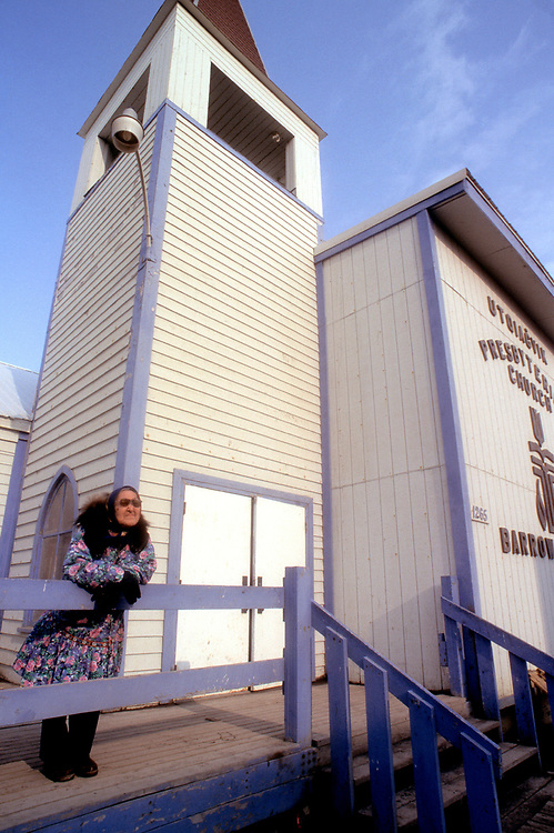 Amy Okpeaha stands outside the Presbiterian Church while waiting for the service in I&ntilde;upiaq to begin. The church is over a hundred years-old.<br /> <br /> May 18, 19:22