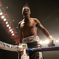 "Simeon Hardy celebrates after knocking out Rahman Yusubov in the first round of the undercard match during the ESPN ""Boxcino"" boxing tournament at Turning Stone Resort Casino on Friday, April 18, 2014 in Verona, New York.  (AP Photo/Alex Menendez)"