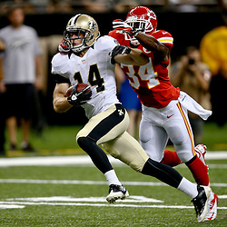 Aug 9, 2013; New Orleans, LA, USA;New Orleans Saints wide receiver Andy Tanner (14) catches a pass over Kansas City Chiefs cornerback Vince Agnew (34) during the second quarter of a preseason game against the Kansas City Chiefs at the Mercedes-Benz Superdome. Mandatory Credit: Derick E. Hingle-USA TODAY Sports