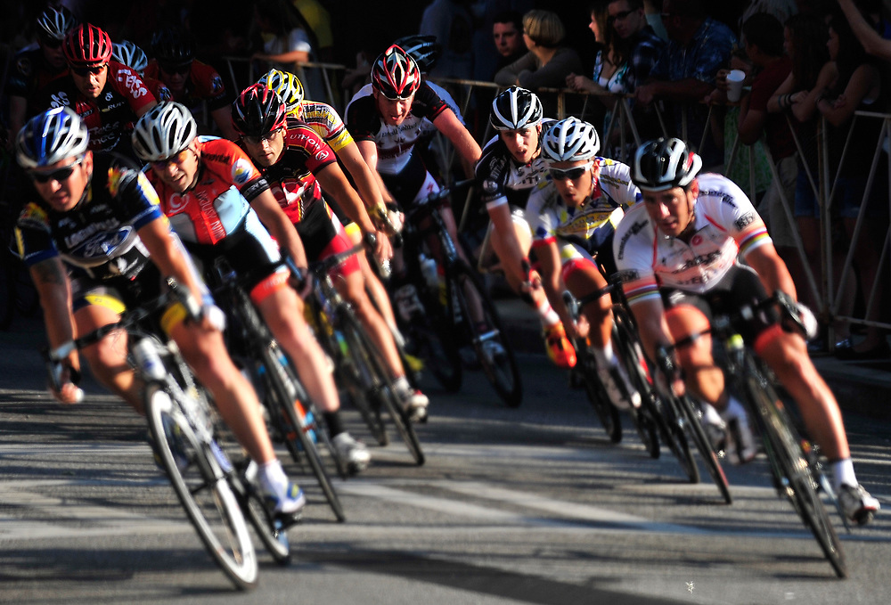 A pack of cyclist make their way through turn two during the Terrapin Pro/Am Twilight Criterium in Downtown Athens, Ga, on Saturday, April 28, 2012.