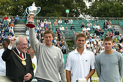 LIVERPOOL, ENGLAND - Sunday, June 22, 2002: Liverpool FC star Stephen Gerrard presents winner Marat Safin (Russia) with the trophy after the Final of the Liverpool International at Calderstones Park, Liverpool. Safin beat Jan-Michael Gambill (USA) 7-6, 6-7, 6-4.