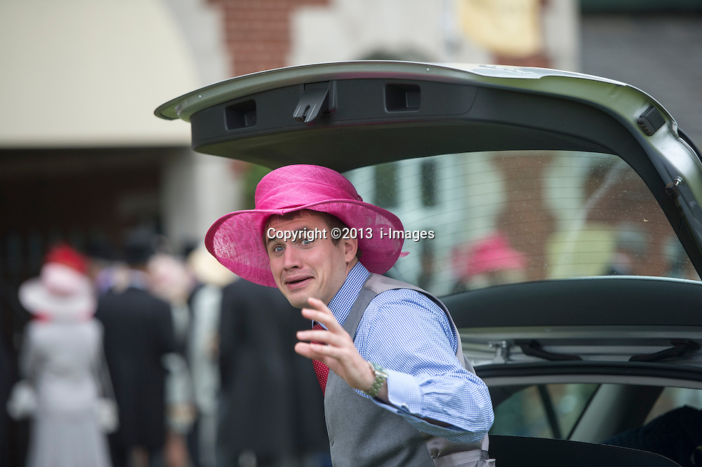 A punter at the point of realising he is being photographed wearing a ladies hat at Royal Ascot 2013,<br /> Ascot, United Kingdom,<br /> Thursday, 20th June 2013<br /> Picture by i-Images
