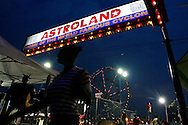 Visitors walk through the Astroland Amusement Park in New York, May 27, 2007. The Coney Island amusement closes for goods at the end of the 2007 season ahead of a major redevelopment that will raze much of the lovably seedy boardwalk area. REUTERS/Keith Bedford (UNITED STATES)