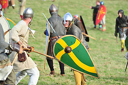 © Licensed to London News Pictures. 13/10/2018<br /> BATTLE, UK.<br /> Saxon warriors (L)  Norman soldiers (R) Green shields.<br /> English Heritage Battle of Hastings re-enactment at Battle Abbey,Battle, on the 1066 battle field.<br /> Photo credit: Grant Falvey/LNP