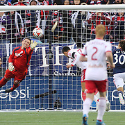 Goalkeeper Bobby Shuttleworth, New England Revolution, tips the ball clear as Tim Cahill, New York Red Bulls, prepares to head the ball during the New England Revolution Vs New York Red Bulls, MLS Eastern Conference Final, second leg. Gillette Stadium, Foxborough, Massachusetts, USA. 29th November 2014. Photo Tim Clayton