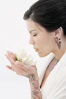 Beautiful woman in commune with lotus bloom.