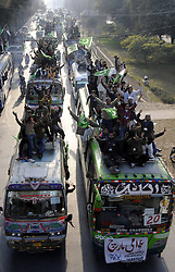 Supporters of Dr Tahir-ul-Qadri ride on vehicles during a long-march in eastern Pakistan s Lahore, Jan. 13, 2013. A Pakistani religious leader, Dr Tahir-ul-Qadri, started a long-march from Lahore to Islamabad to call for electoral reforms Sunday, local media reported, January 13, 2013. Photo by Imago / i-Images...UK ONLY