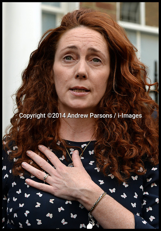 Image ©Licensed to i-Images Picture Agency. 26/06/2014. London, United Kingdom. Rebekah and Charlie Brooks giving a statement on Phone hacking verdict outside her house in London. Picture by Andrew Parsons / i-Images
