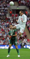 Wayne Rooney outjumps Robert Koren during the international friendly match between England and Slovenia at Wembley Stadium, London on the 5th September 2009