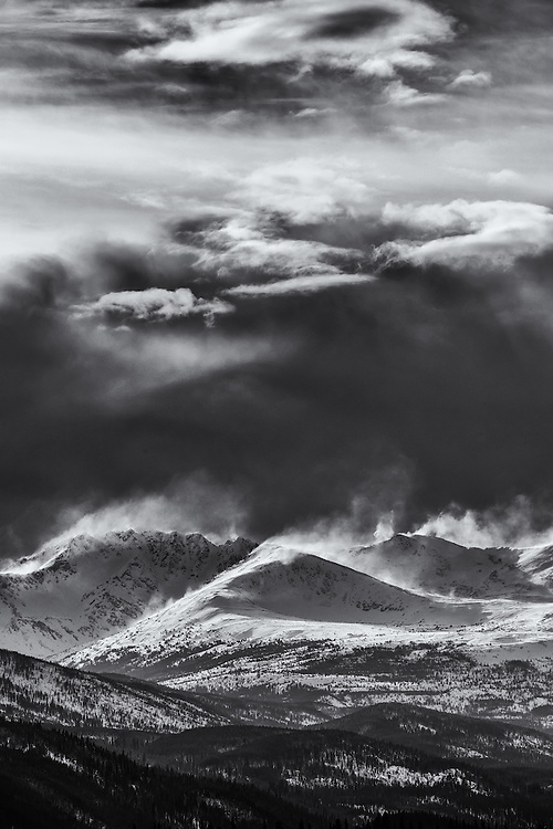 High winds blowing snow from the tops of the Cassiar Mountains