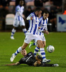 Aston Villa's James Chester (floor) tries to tackle Colchester United's Drey Wright during the Carabao Cup, First Round match at the Weston Homes Community Stadium, Colchester.