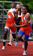 8 MAY 2010 -- COLLINSVILLE, Ill. -- East St. Louis runners Kendrick Lewis (left) and Keante Minor (CQ) struggle to complete a hand off during the 4x200-meter relay at the Collinsville Invitational at Collinsville High School Saturday, May 8, 2010. Their baton issues pushed the Flyers, the team with the top time coming into the meet, into a lower finishing spot. Photo © copyright 2010 by Sid Hastings.