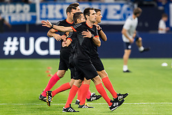 the Spanish referee team with referee Jesus Gil Manzano do the warming up DFL REGULATIONS PROHIBIT ANY USE OF PHOTOGRAPHS AS IMAGE SEQUENCES AND/OR QUASI-VIDEO. during the UEFA Champions League group D match between Schalke 04 and FC Porto at the Arena auf Schalke on September 18, 2018 in Gelschenkirchen, Germany