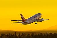 C-ANJ taking off in the pre-dawn light