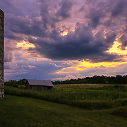 &quot;Silo Sunset Two&quot;<br /> <br /> Wow! What an amazing sky at sunset with a grain silo and farm outbuildings on a Midwestern farm!