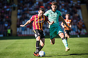 Dylan Connolly of Bradford City runs with the ball from Jack Iredale of Carlisle United during the EFL Sky Bet League 2 match between Bradford City and Carlisle United at the Utilita Energy Stadium, Bradford, England on 21 September 2019.