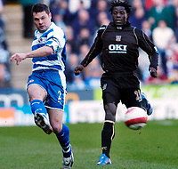 Photo: Leigh Quinnell.<br /> Reading v Portsmouth. The Barclays Premiership. 17/03/2007. Readings Graham Murty gets the ball away from Portsmouths Benjani Mwaruwari.