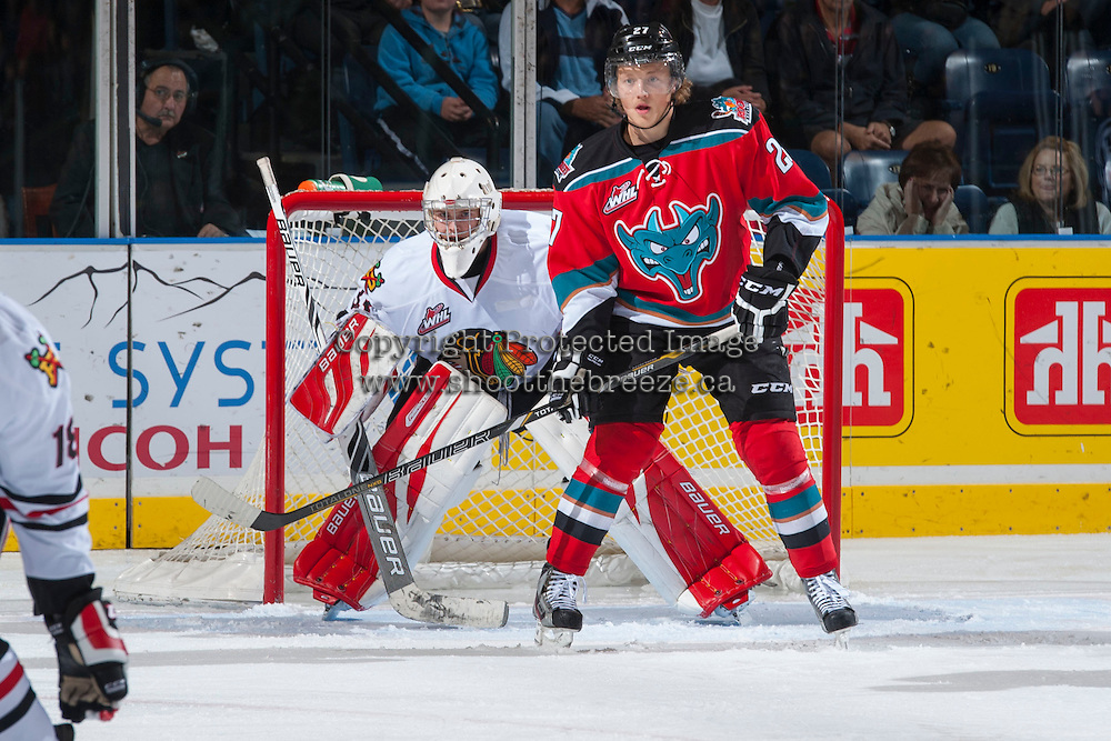 KELOWNA, CANADA - OCTOBER 5:  Ryan Olsen #27 of the Kelowna Rockets stands in front of the goal of Jarrod Schamerhorn #33 of the Portland Winterhawks at the Kelowna Rockets on October 5, 2013 at Prospera Place in Kelowna, British Columbia, Canada (Photo by Marissa Baecker/Shoot the Breeze) *** Local Caption ***